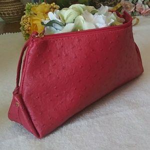 Red Estée Lauder cosmetic bag faux ostrich